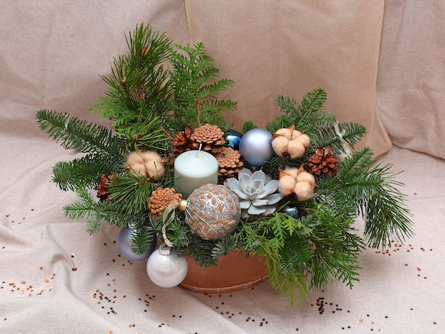 Christmas composition of pine branches, cones, cotton, balls and