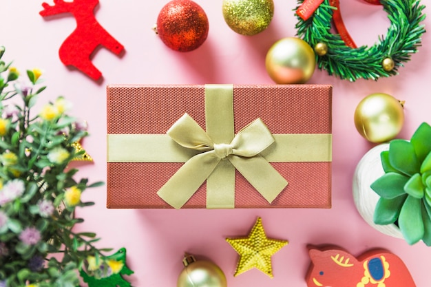 Christmas composition of pink gift box with baubles