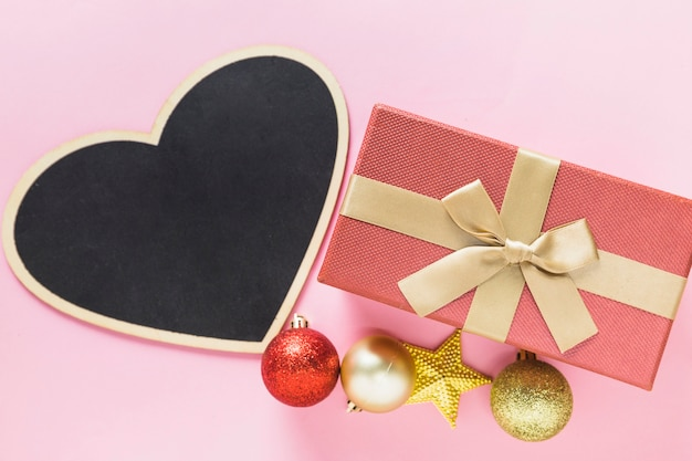 Christmas composition of pink gift box with chalkboard