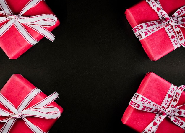 Christmas composition of pink gift boxes