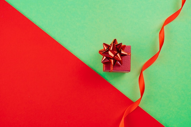 Christmas composition. present box on red and green background. copy space. ace.