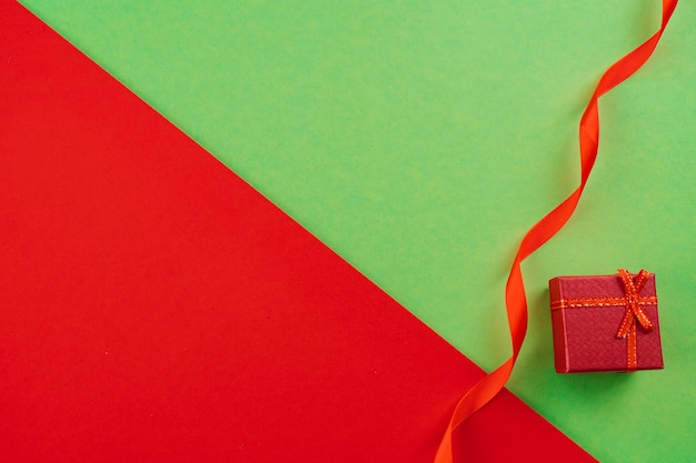Christmas composition. present box on red and green background. copy space.