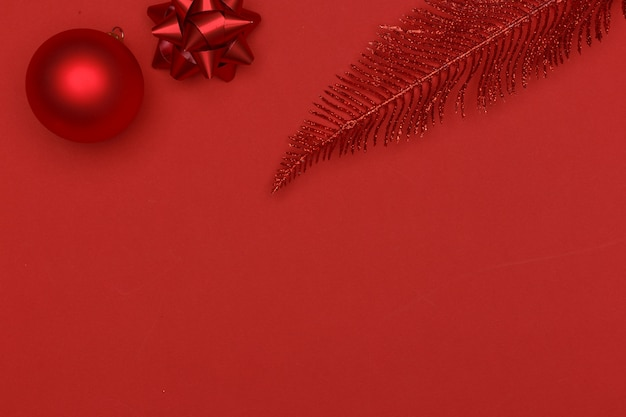 Christmas composition. red elements of christmas decor on a red background.