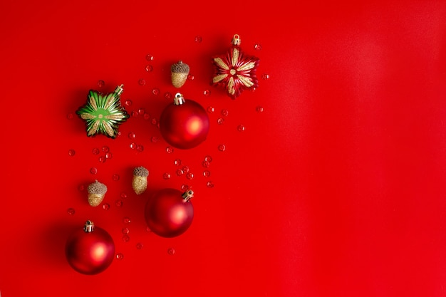 Christmas composition: red, gold and green decorations on a red