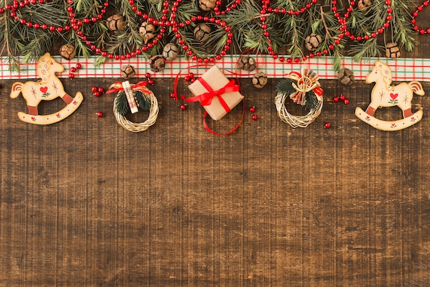 Christmas composition of small wreaths and gift box