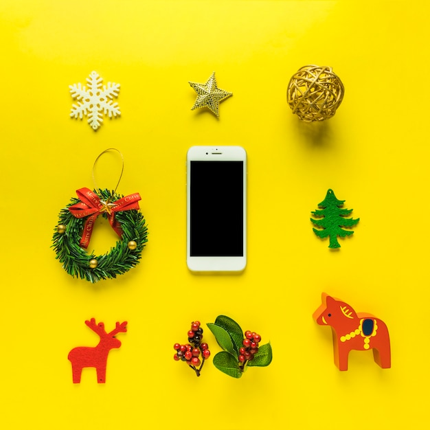 Christmas composition of smartphone with toys