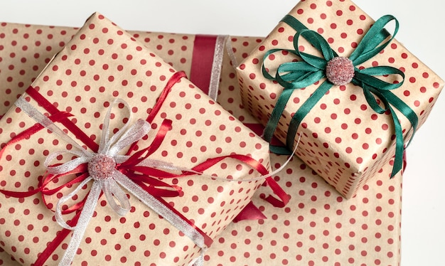 Christmas composition of various gift boxes wrapped in craft paper and decorated with satin ribbons. top view, flat lay.