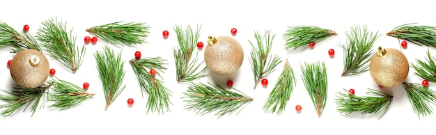 Christmas composition on a white background. pine branches and golden christmas balls.