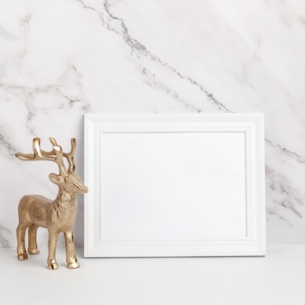 Christmas composition. white framed christmas decorations and gifts on a marble background