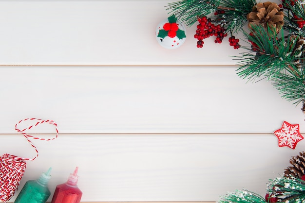 Christmas composition on white wooden boards