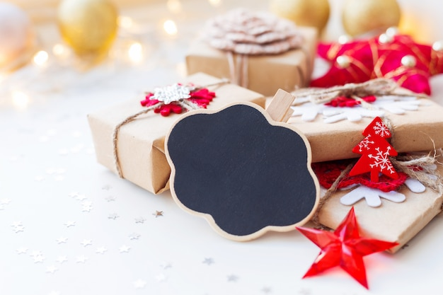Christmas composition with cloud chalkboard, presents and decorations