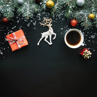 Christmas composition with coffee cup and present box