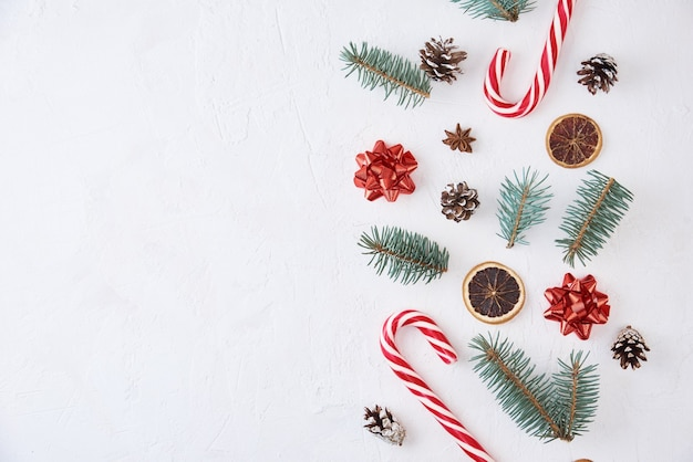 Christmas composition with copy space. decoration made of fir tree branches, pine cones and sweets on white background