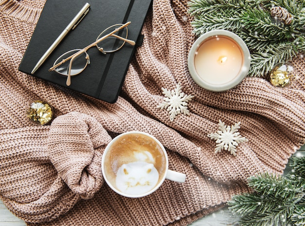 Christmas composition with cup of coffee and decorations