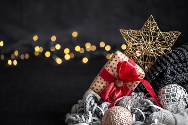 Christmas composition with decor details on a blurred dark background close up.