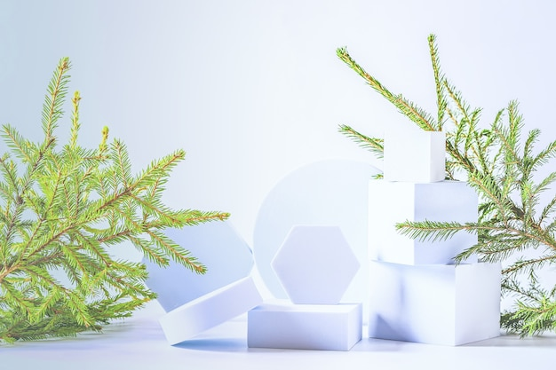Christmas composition with fir tree and empty podiums. soft selective focus. winter festive background.