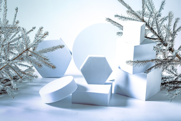 Christmas composition with fir tree and empty podiums soft selective focus winter festive background