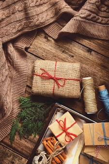 Christmas, composition with gift boxes and knitted blanket. preparing for the winter holidays