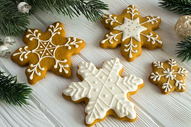 Christmas composition with gingerbread and fir branches