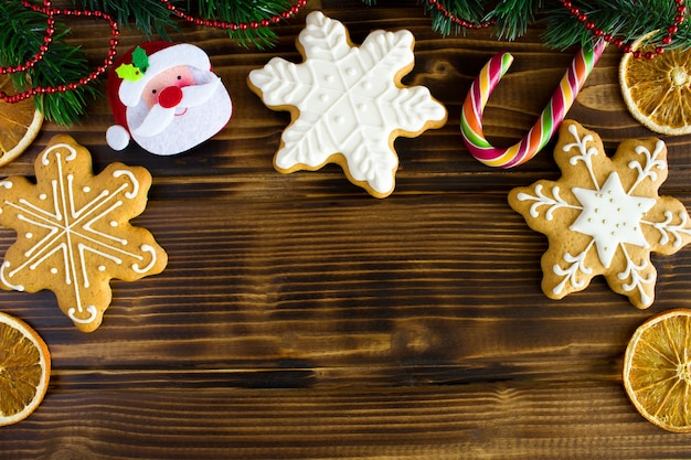 Christmas composition with gingerbread on the wooden.