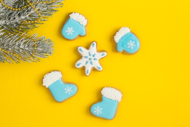 Christmas composition with gingerbread on the yellow background. top view. copy space.
