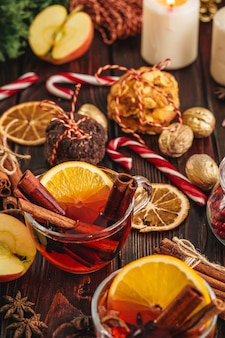Christmas composition with glass of glint wine on wooden table close up