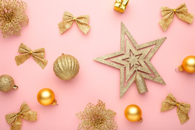 Christmas composition with gold decoration on pink