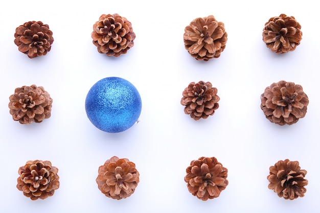 Christmas composition with pine cones and blue christmas ball on white background