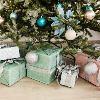 Christmas composition with presents under christmas tree