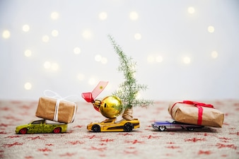 Christmas composition with presents on toy cars