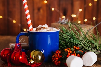 Christmas composition with straw in mug