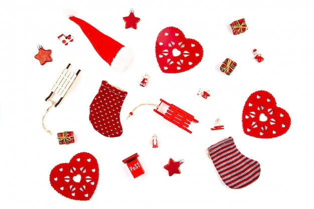 Christmas composition with   wooden decorations over the white background.