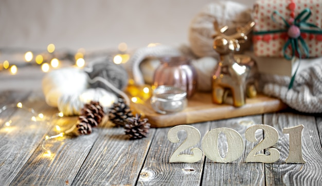 Christmas composition with wooden number for the coming year on the background of decor details.