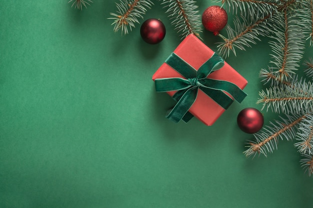Christmas composition with xmas tree and red gift on green . greeting card. . . copyspace
