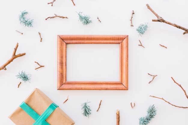 Christmas composition of wooden frame with gift box