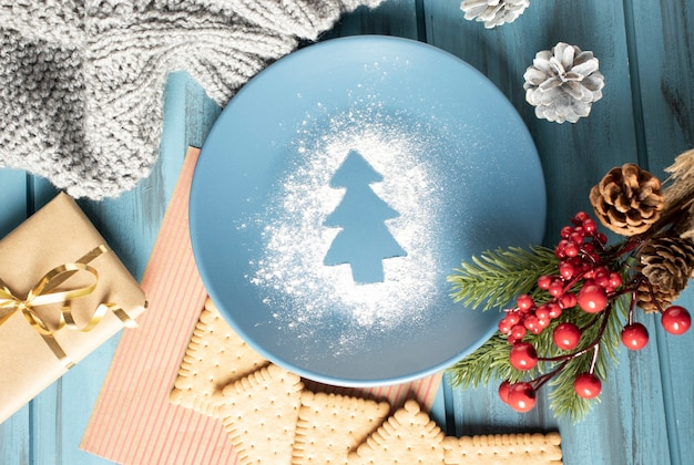 Christmas composition on a wooden surface with cookies