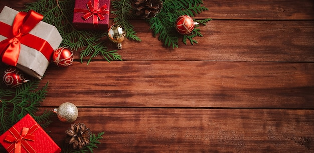 Christmas composition on wooden table. gift boxes and festive decor. place for text.