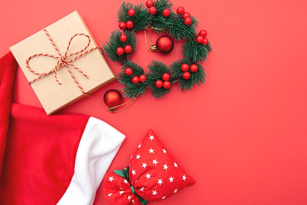 Christmas composition, wreath, christmas toy and bag, winter holiday concept picture