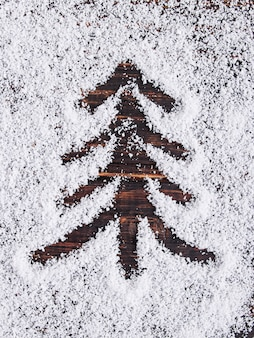 Christmas concept background, painted tree on white snow, holiday symbol.