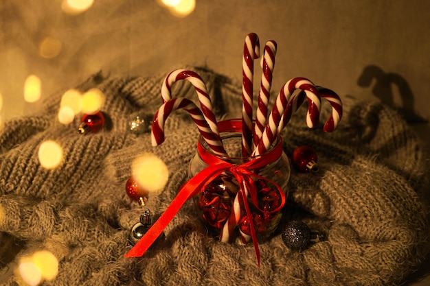 Christmas concept. christmas composition with sweets and christmas decorations on gray plaid.