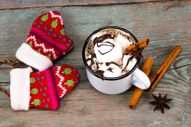 Christmas concept, hot chocolate or cocoa with marshmallows and spices.