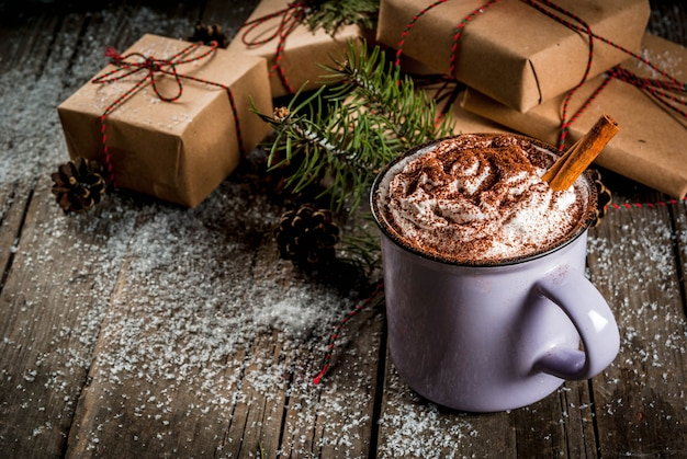 Christmas concept, hot chocolate or cocoa with whipped cream and spices