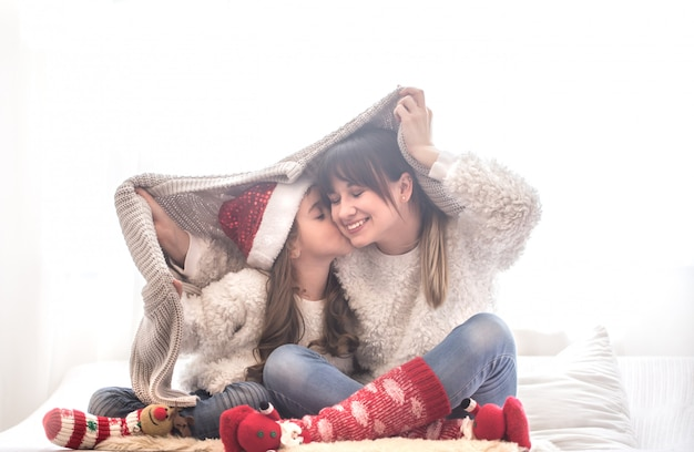 Christmas concept, mom and her daughter playing