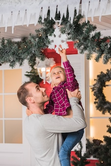Christmas concept with father holding daughter