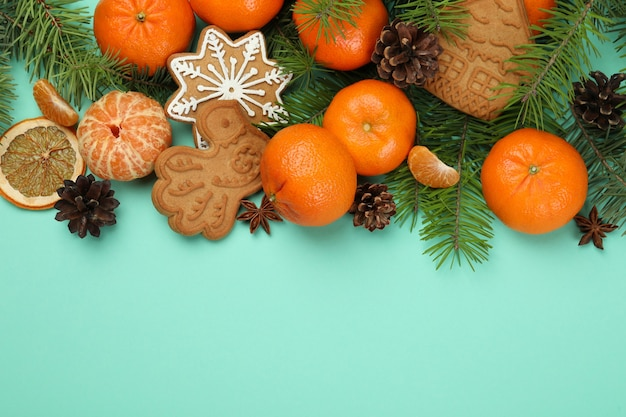 Christmas concept with mandarins on mint background