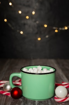 Christmas concept with marshmallow drink and lights