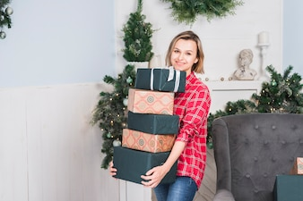 Christmas concept with mother carrying gift boxes