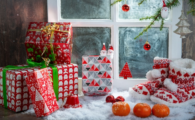 Christmas concept with slippers, oranges and gifts