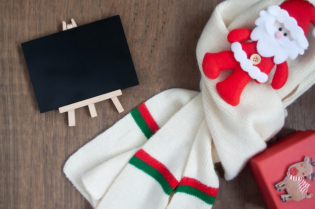 Christmas concept with winter and celebration items on wooden background