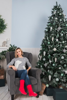 Christmas concept with woman on couch